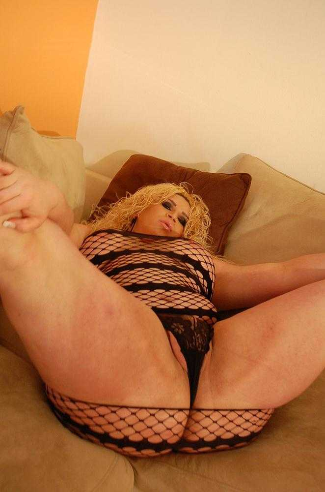 Big tit Ts in fishnets and not much else